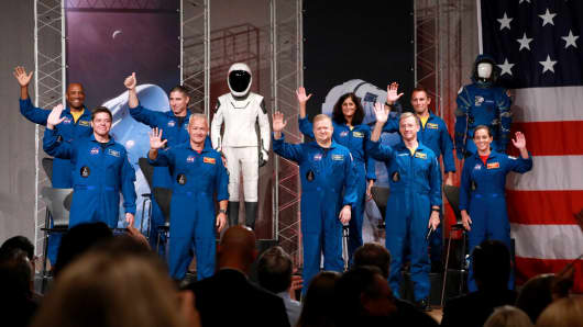 The astronauts assigned to crew the first flight tests and missions of the Boeing CST-100 Starliner and SpaceX Crew Dragon acknowledge the media upon introduction at NASA's Johnson Space Center in Houston, Texas, U.S., August 3, 2018. The astronauts are (L to R): Victor Glover, Robert Behnken, Michael Hopkins, Douglas Hurley, Eric Boe, Sunita Williams, Christopher Ferguson, Josh Cassada, and Nicole Mann.