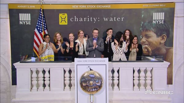 Officials and guests of the charity: water, ring Friday's closing bell at the NYSE