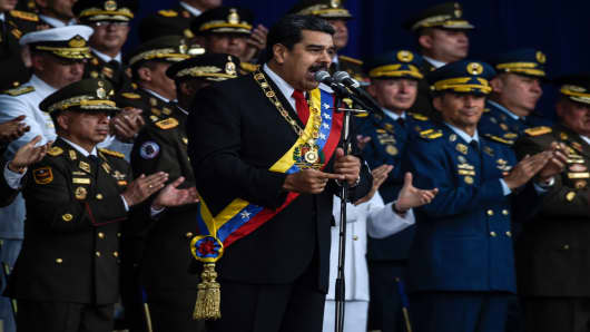 Venezuelan President Nicolas Maduro delivers a speech during a ceremony to celebrate the 81st anniversary of the National Guard in Caracas on August 4, 2018. Maduro was unharmed after an exploding drone 'attack', the minister of communication Jorge Rodriguez said following an incident that saw uniformed military members break ranks and scatter after a loud bang interrupted the leader's remarks and caused him to look to the sky, according to images broadcast on state television.
