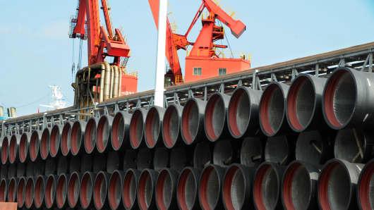 Pipes sit stacked at Lianyungang Port on July 31, 2018 in Lianyungang, Jiangsu Province of China.