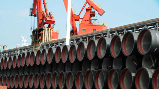 Pipes sit stacked at Lianyungang Port on July 31, 2018 in Lianyungang, Jiangsu Province of China.