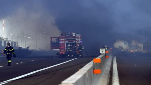 Firefighters work at the scene where a tanker truck exploded on a motorway just outside Bologna, northern Italy, on August 6, 2018 (Photo by - / AFP)        (Photo credit should read -/AFP/Getty Images)