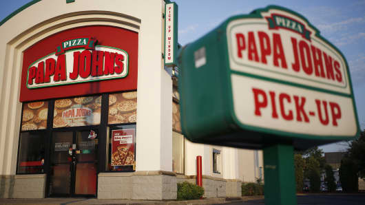 Signage is displayed outside a Papa John's International pizza restaurant in Louisville, Kentucky.