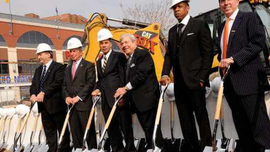 Forest City Ratner Companies Chairman and CEO Bruce Ratner, New York Mayor Michael R. Bloomberg, New York State Governer David Paterson, Brooklyn Borough President Marty Markowitz, Rapper and NETS investor Shawn 'Jay-Z' Carter and Barclays PLC President Robert R. Diamond pose for a photo at the ceremonial groundbreaking for Barclays Center at Atlantic Yards on March 11, 2010 in New York City.