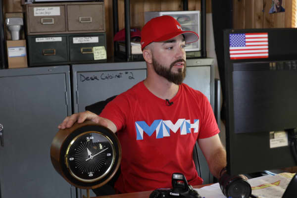 Mark Meyer looks up comparable Howard Miller clocks on eBay to figure out the price at which he should list the one he's found.