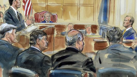 This courtroom sketch depicts Rick Gates, right, answering questions by prosecutor Greg Andres as he testifies in the trial of Paul Manafort, seated second from left, at the Alexandria Federal Courthouse in Alexandria, Va., Monday, Aug. 6, 2018.