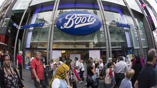 Members of the public walk past a branch of Boots the chemist on Oxford Street on August 6, 2014 in London, England.