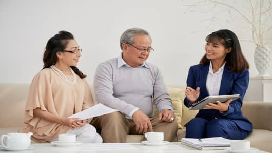 Retired couple meeting with financial adviser