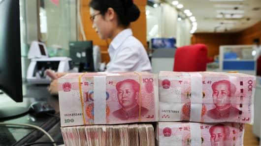 Chinese 100-yuan notes at a bank in Nantong in China's eastern Jiangsu province.