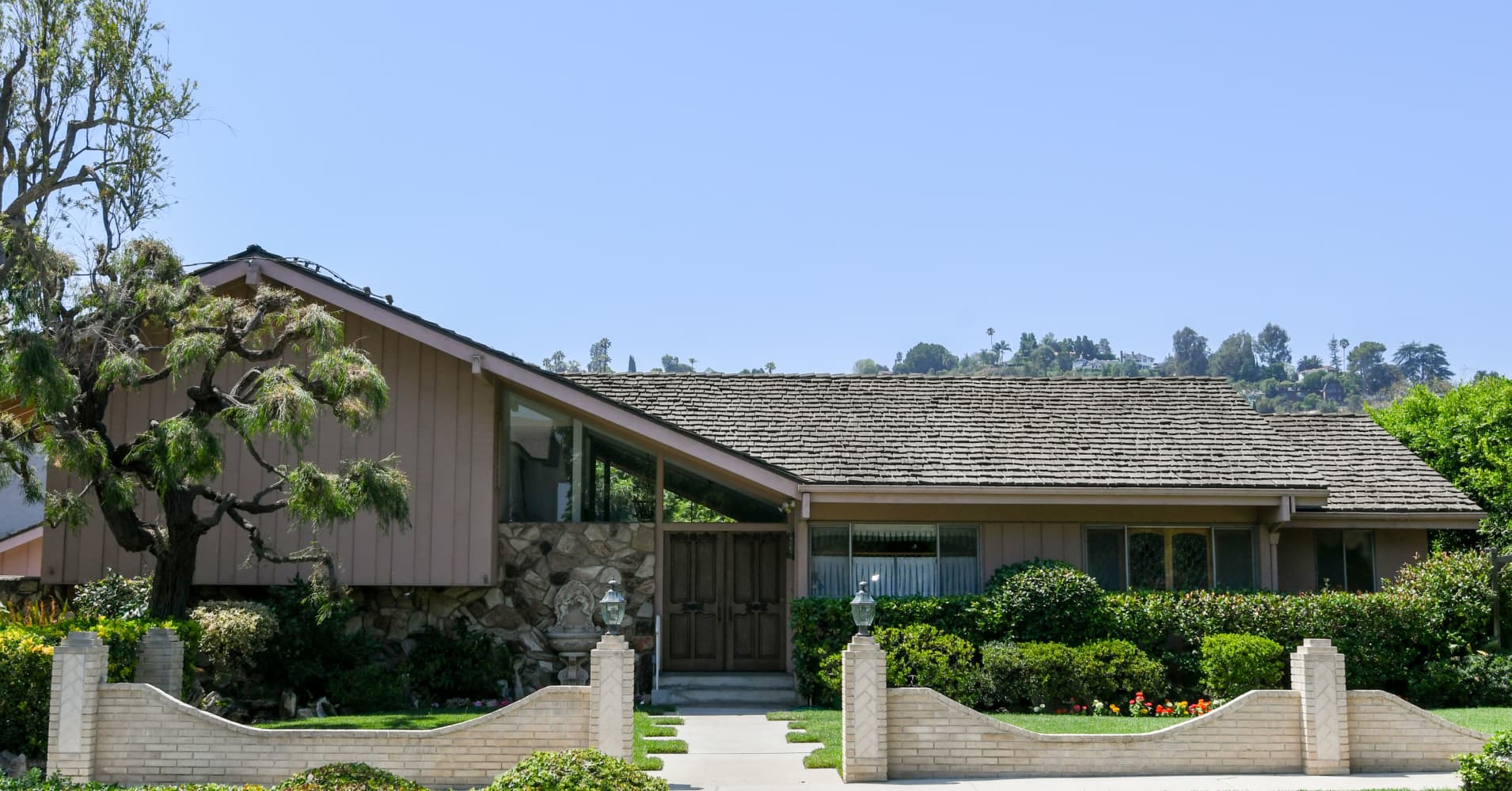 HGTV buys, plans to restore 'Brady Bunch' house and Lance Bass is cool with it
