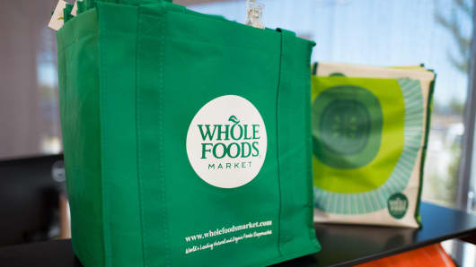Reusable shopping bag with logo at Whole Foods Market grocery store in Dublin, California.