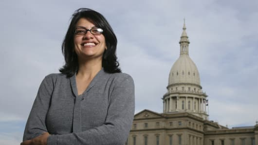 Democrats pick former Michigan state Rep. Rashida Tlaib to run unopposed for the congressional seat that former Rep. John Conyers held for more than 50 years.