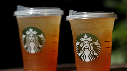 A new flat plastic lid that does not need a straw is shown on a cup of Starbucks iced tea in Sausalito, California.