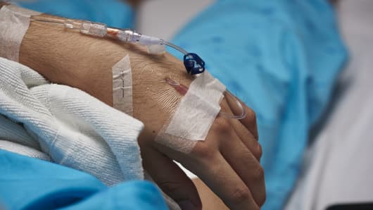 iv line for fluid for patient lying on the bed admitted in hospital