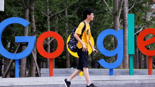 A man walks past the brand logo of Alphabet Inc's Google outside its office in Beijing, China, August 8, 2018.