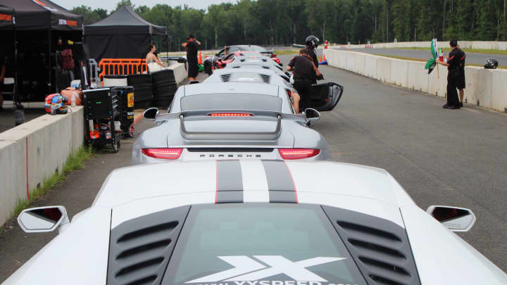 Super cars line up to hit the track.