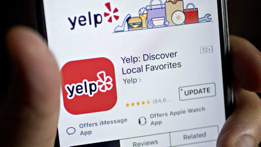 The Yelp app is seen on an Apple iPhone.