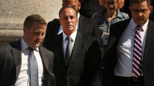 Rep. Chris Collins (R-NY) (centre) walks out of a New York court house after being charged with insider trading on August 8, 2018 in New York City.