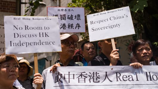Members of a pro-government group gather outside the Foreign Correspondents' Club in Hong Kong to protest a scheduled talk by pro-independence advocate Andy Chan Ho-tin.