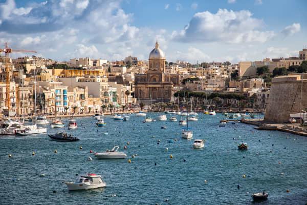 Sailing boats on Senglea marina in Grand Bay, Valetta, Malta.