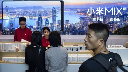 Consumers purchasing Xiaomi products at its flagship store in Hong Kong.