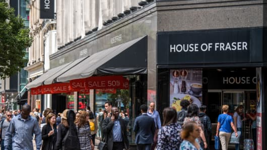 Pedestrians pass a House of Fraser store, one of the stores slated for closure, on Oxford Street, in central London, U.K., on Wednesday, June 13, 2018.