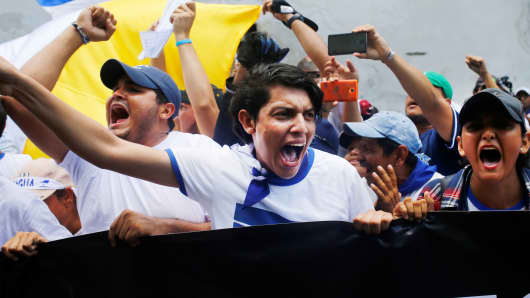 Students yell slogans during an anti-government protest outside the National Autonomous University of Nicaragua (UNAN) in Leon, Nicaragua, July 30, 2018.
