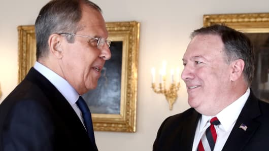 Russia's Foreign Minister Sergei Lavrov (L) and US Secretary of State Mike Pompeo meet on the sidelines of a presidential summit between Russia and the United States held at the Presidential Palace.