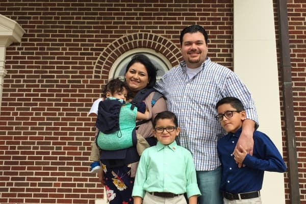 Joshua Shroyer, 33, with his wife and three sons.