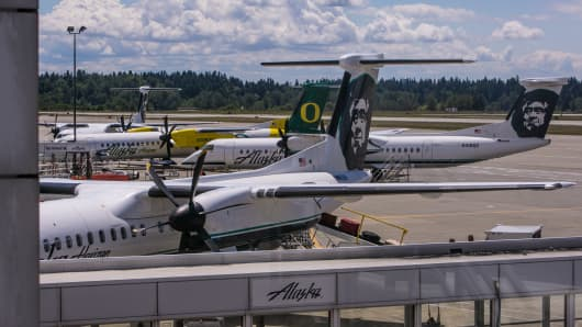 Alaska Airlines Bombardier Q-400 turbo-prop planes are parked at Seattle-Tacoma International Airport's C terminal on June 2, 2013, in Seattle, Washington.