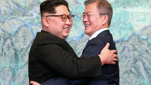 North Korean leader Kim Jong Un (L) and South Korean President Moon Jae-in (R) embrace after signing the Panmunjom Declaration for Peace, Prosperity and Unification of the Korean Peninsula during the Inter-Korean Summit at the Peace House on April 27, 2018 in Panmunjom, South Korea.