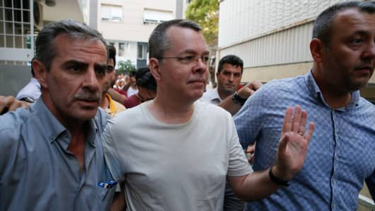 American Pastor Andrew Craig Brunson (C), who was charged with committing crimes, including spying for the PKK terror group and the Fetullah Terrorist Organization, arrives at the address, which he was put under house arrest due to his health problems, in Izmir, Turkey on July 25, 2018. (Photo by Evren Atalay/Anadolu Agency/Getty Images)
