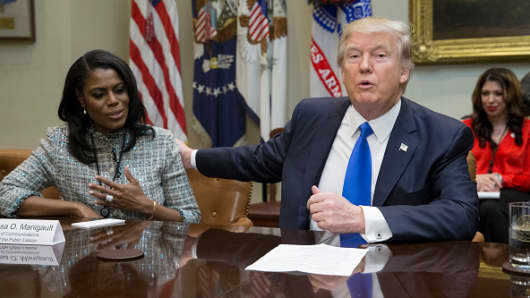 President Donald Trump holds an African American History Month listening session attended by Director of Communications for the Office of Public Liaison Omarosa Manigault (L) and other officials in the Roosevelt Room of the White House on February 1, 2017 in Washington, DC.