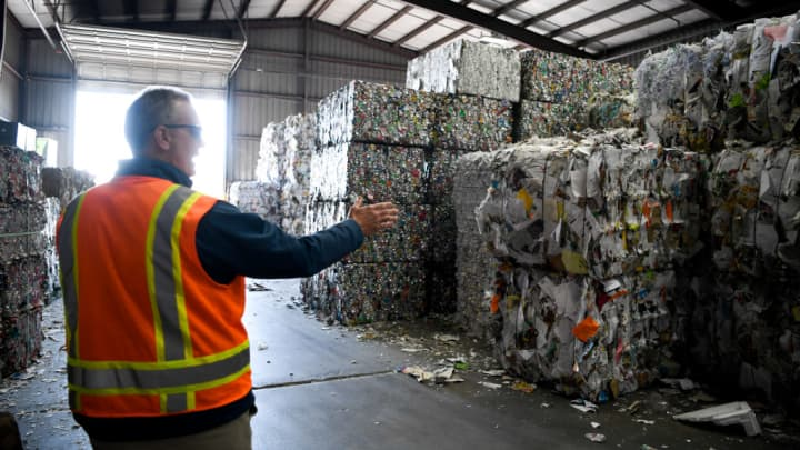 Vice president of recycling Brent Hildebrand walks through bundles of recyclables at Alpine Waste & Recycling on Tuesday, March 13, 2018. Alpine is making efforts to clean up their paper recycling stream by adding more employees to the production line in order to ensure contaminants are limited such as separating brown paper from white.