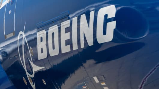 A Boeing Co. logo is seen on the fuselage of a Boeing Co. 787 Dreamliner aircraft.