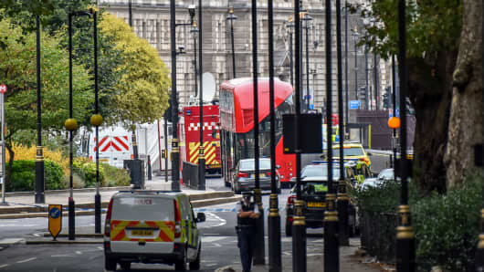 Police officers secure the roads around the Houses of Parliament as forensic teams continue their work around a vehicle after it crashed into security barriers, outside the Houses of Parliament on August 14, 2018 in London, England.