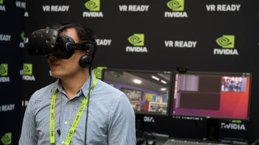 Simpson Chung uses a virtual reality headset during the NVIDIA GPU Technology Conference, which showcases artificial intelligence, deep learning, virtual reality and autonomous machines, in Washington, DC.