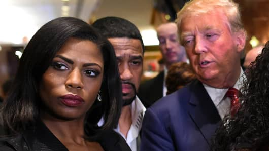 Omarosa Manigault (L)  who was a contestant on the first season of Donald Trump's 'The Apprentice' and is now an ordained minister, appears alongside Republican presidential hopeful Donald Trump during a press conference November 30, 2015  that followed Trump's meeting with African-American religious leaders in New York.