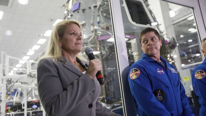 Gwynne Shotwell president and chief operating officer of SpaceX, left, speaks as NASA astronaut Bob Behnken looks on.