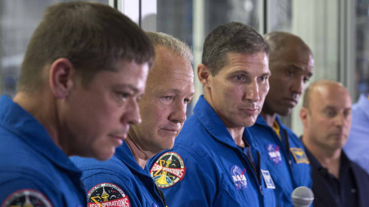 NASA Astronauts Bob Behnken, Doug Hurley, Mike Hopkins and Victor Glover talk to reporters during a media tour of SpaceX headquarters.