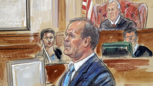 This Aug. 7, 2018 courtroom sketch depicts Rick Gates, right, testifying during questioning in the bank fraud and tax evasion trial of Paul Manafort at federal court in Alexandria, Va. The judge is T.S. Elliot III.