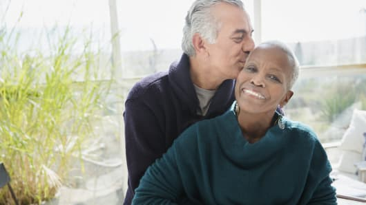 Portrait affectionate senior couple hugging and kissing