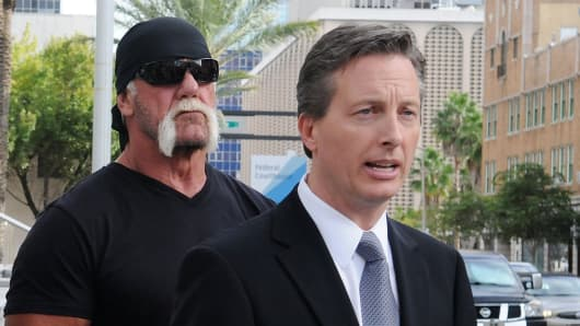 TV personality Terry Bollea aka Hulk Hogan(C) and his attorney Charles Harder (R) attend a press conference to discuss legal action being brought on his behalf October 15, 2012 in Tampa, Florida.