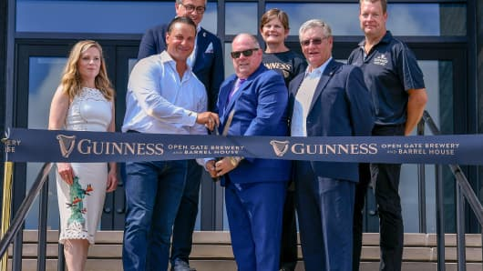 Diageo and Guinness executives cut the ribbon on the Guinness Open Gate Brewery  & Barrel House with Governor Larry Hogan, and County Executive Don Mohler on August 2, 2018 in Halethorpe, Maryland. Pho   tographed (L-R) Guinness Brand Director Emma Giles; Diageo Beer Co. U.S.A Chairman and Diageo Global Chief Sales Officer Tom Day; Diageo Beer Co. U.S.A President Nuno Teles; President Diageo North America Deirdre Mahlan; Governor Larry Hogan; County Executive Don Mohler; and President of Supply, Diageo North America, Erik Snyder. on August 2, 2018 in Halethorpe, Maryland.