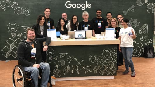 A group of Google employees, including Allen (center), prepare to give product demonstrations at an Assistive Technology Industry Association conference