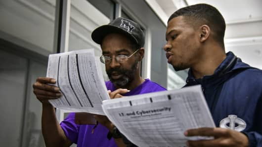 During a weeklong job training program, Keith Mitchell, Jr., L, and Isaiah Hall, 21, excitedly look over the class lists of IT certification programs at Metropolitan Community College in North Omaha on Wednesday, May 2, 2018, in Omaha, NE.  The two of them - one a resident of a homeless shelter and the other a young man living with his great grandmother, would bond over common interests during the week.