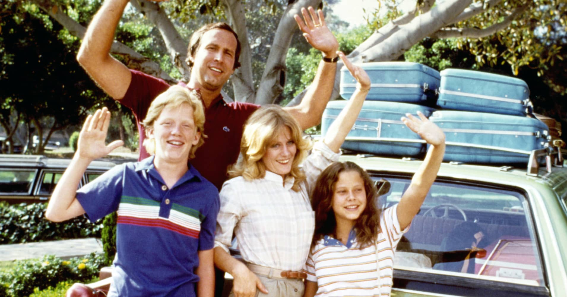 Anthony Michael Hall, Chevy Chase, Beverly D'Angelo, and Dana Barron waving from car in a scene from the film 'Vacation', 1983.