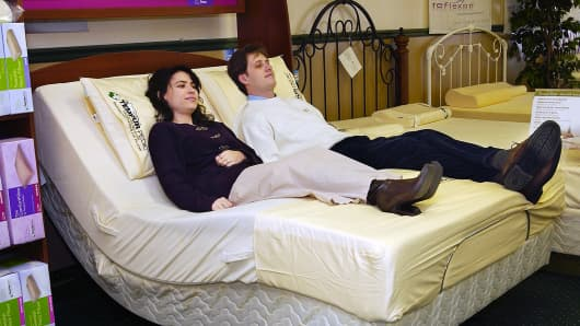 Managers of Sleep Quarters at Clark's Pond in South Portland, relax on one of their Tempur-Pedic beds.