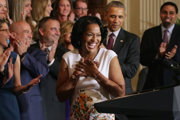 National Teacher of the Year Jahana Hayes (C) has a hard time controlling her excitement after taking the stage with U.S. President Barack Obama (2nd R), Education Secretary John King (R) and her fellow state teachers of the year during a White House ceremony on May 3, 2016.