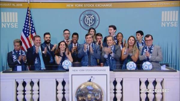 New York City Football Club rings the opening bell at the NYSE